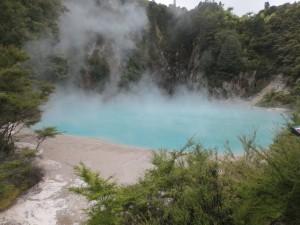 Blue acidic-pH pond emitting steamng