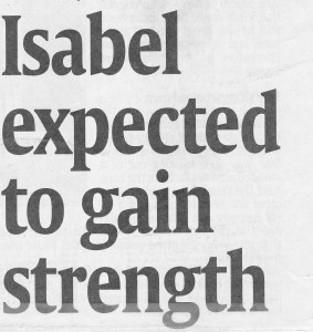 Scanned newspaper headline: Isabel expected to gain strength
