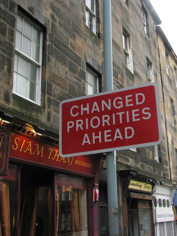 Red and white traffic sign in Edinburgh: Changed Priorities Ahead