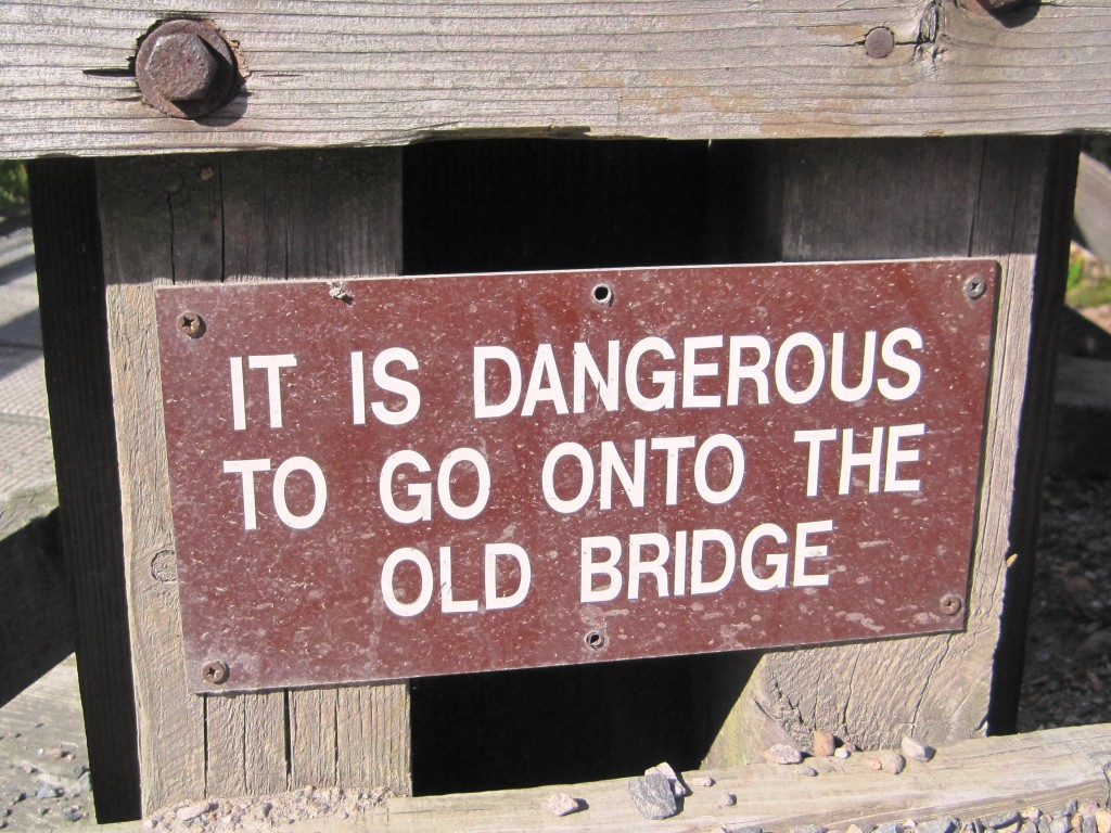 Sign saying: It is dangerous to go onto the old bridge