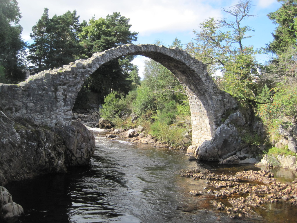 Arched stone bridge with 5-foot displacement in arch.