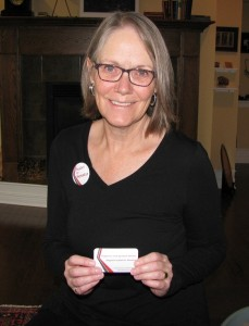 Isabel Gibson with campaign button and business card.