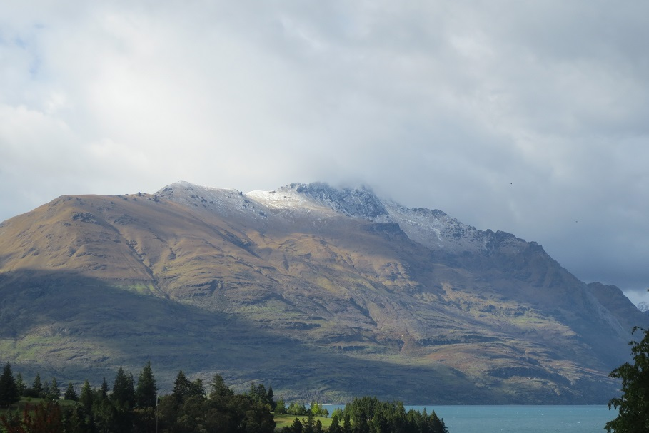 Early morning lights a mountain over a lake at Queenstown NZ.