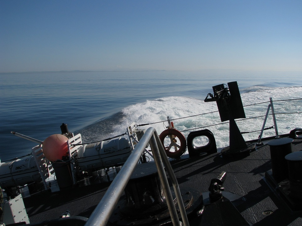 View of frigate's helicopter deck, canted to starboard.