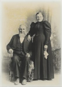 Black and white studio portrait of old couple in 1894.