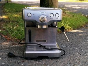 Stainless steel Breville coffee maker in a Vancouver alley.