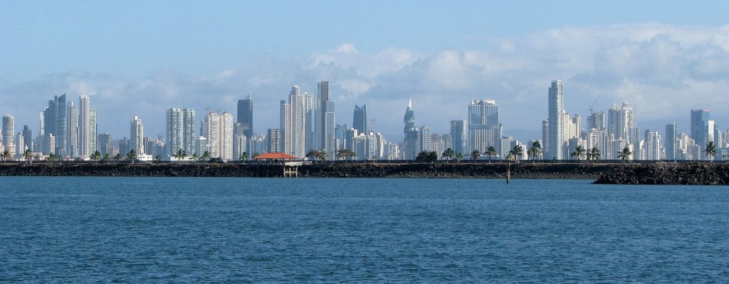 Panama City skyline with harbour and causeway in foreground.