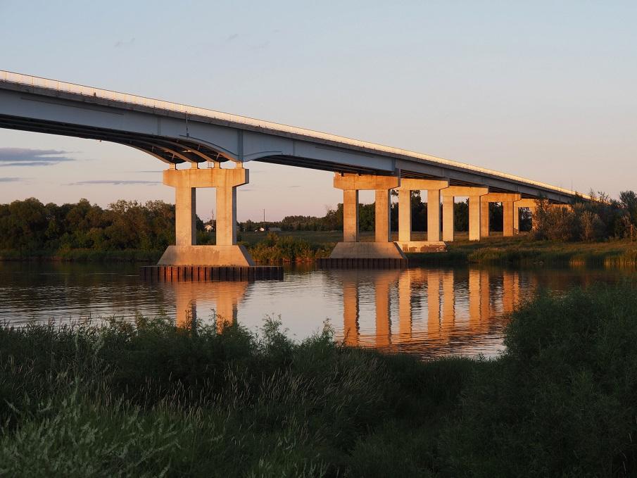 Cement pillar bridge at sunset