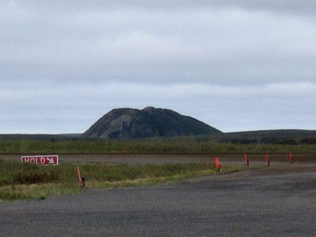 Irregular ice-dome hill near Tuktoyaktuk Airport.