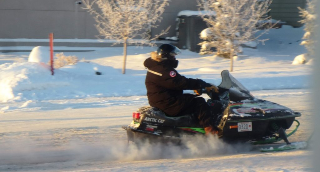 Snowmobiler on Yellowknife street.