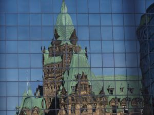 West Block reflection in office building across the street.