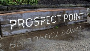 Prospect Point's wetahered sign and its reflection.