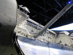 Canadarm in Space Shuttle Atlantis, on display at Kennedy Space Center