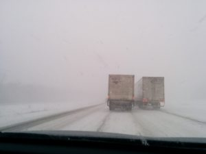 Snowy intertstate road in snow storm