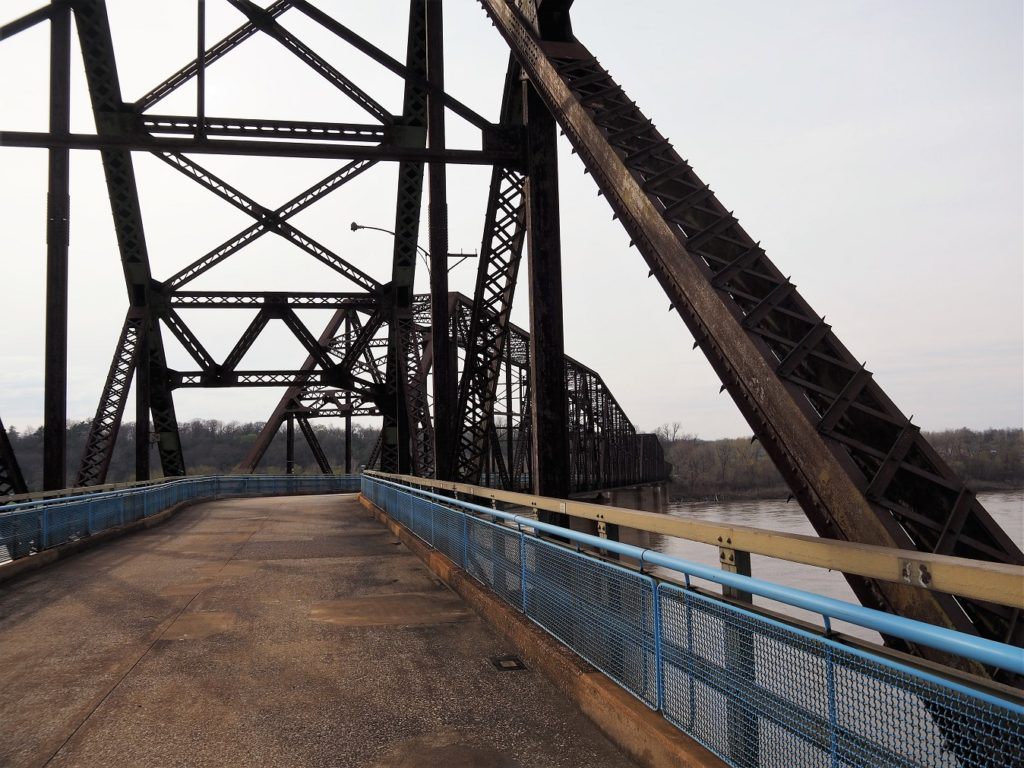 Deck-level view of bend in bridge.