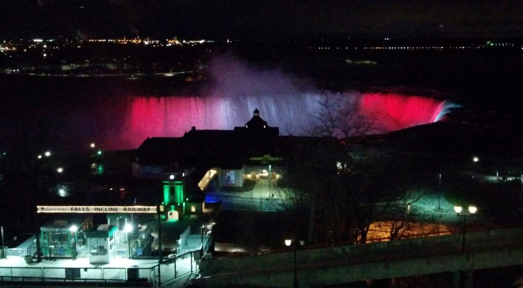 Horsehshoe Falls illuminated with coloured lights.