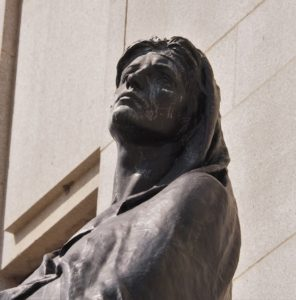 Close-up of bronze statue, Truth, in front of Supreme Court of Canada