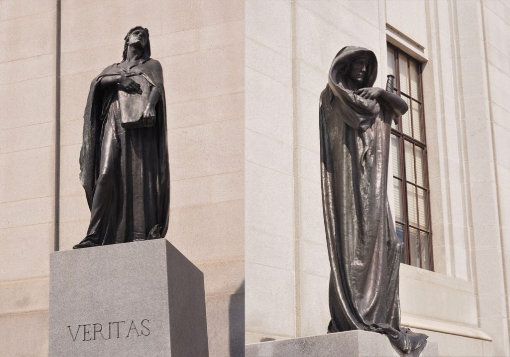 Full-figure shots of bronze statues in front of Supreme Court of Canada