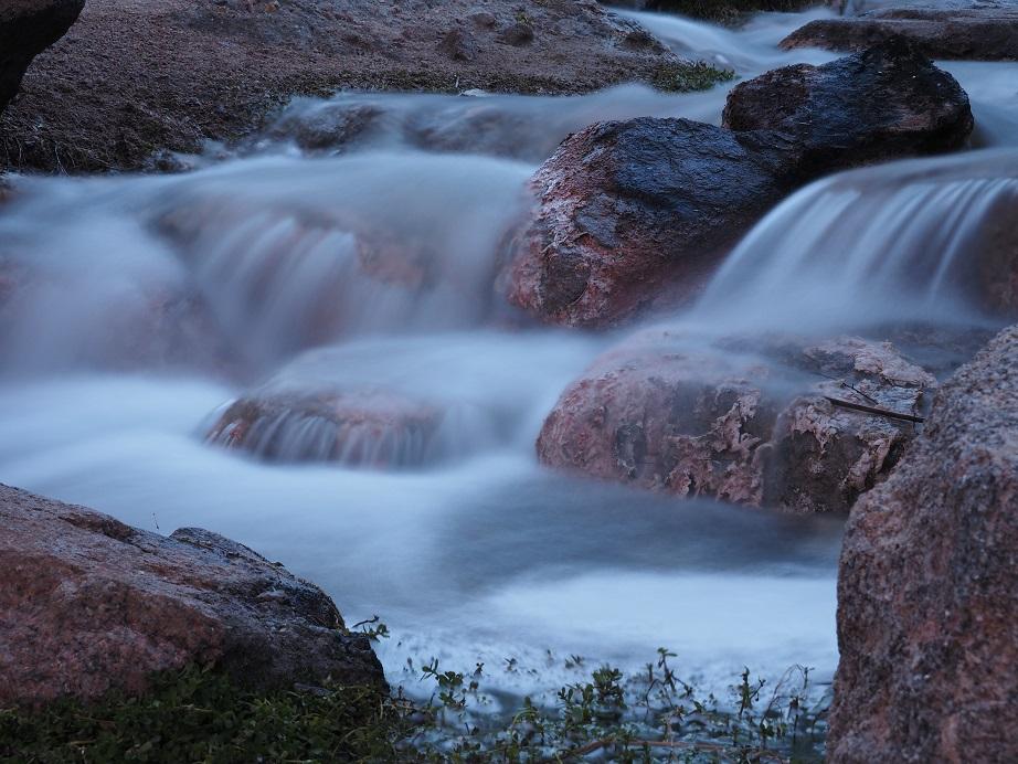 Long-exposure shot of rocky waterfall.