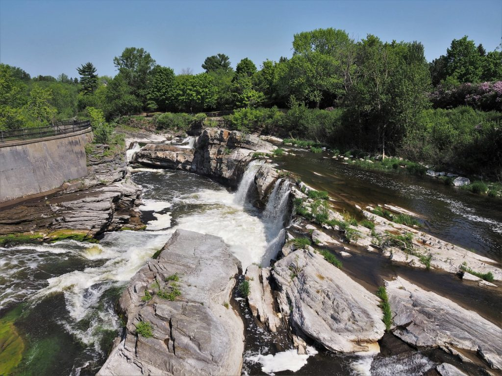 Rocky outbreak forming Hogsback Falls, near locks on Rideau River.