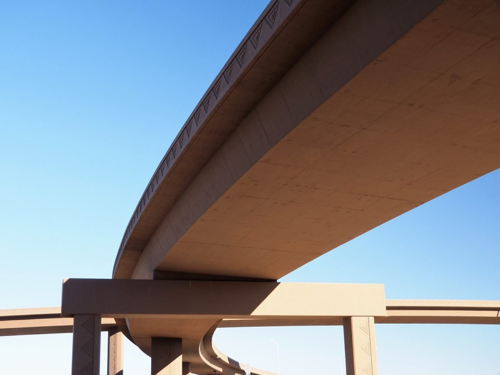Arch of freeway ramp. seen from underneath.
