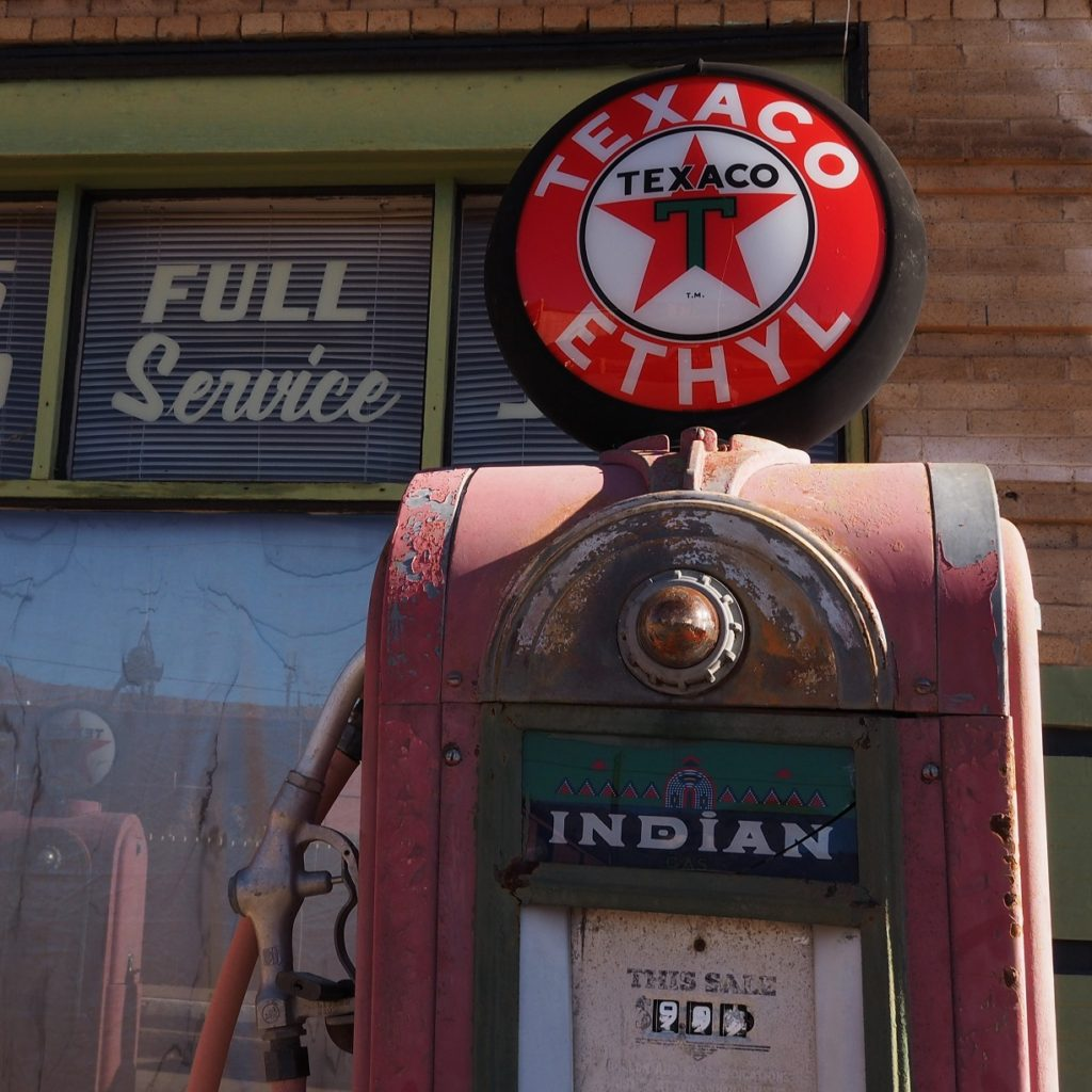 Old gas pump with new Texaco sign on top.