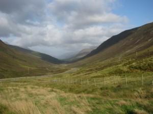 Pass through mountains en route to Skye; grassy foreground.