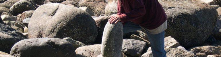 Kent Avery balancing rocks in Stanley Park