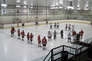 Two pick-up teams line up for the start of a hockey game