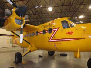 Yellow Twin Otter in hangar in Yellowknife.
