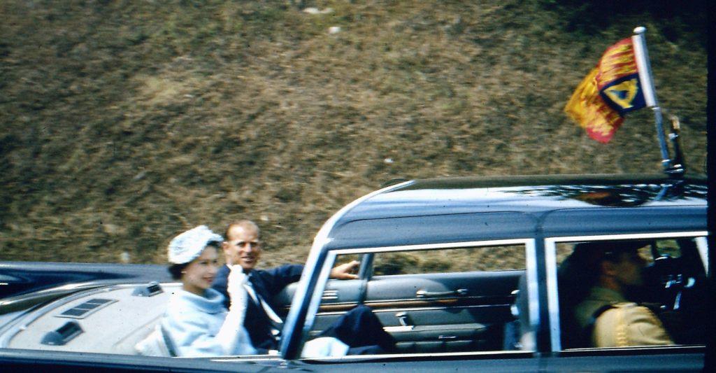 Queen Elizabeth II and Prince Philip in open touring car, Edmonton AB, 1959