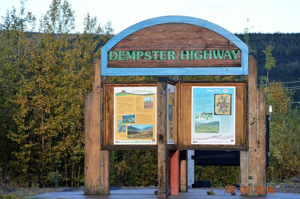 Sign marking southern start of Dempster Highway.