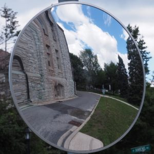 Reflection in corner-mounted circular mirror on RMC campus.