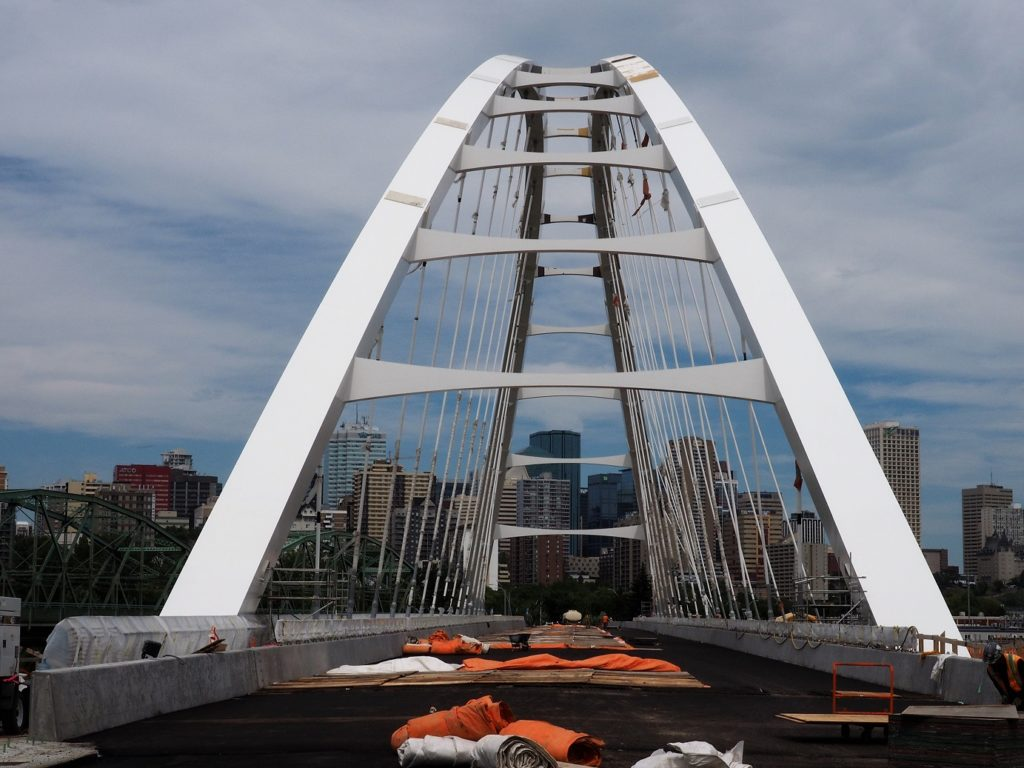 Straight-on shot of arches of new Walterdale Bridge still under construction