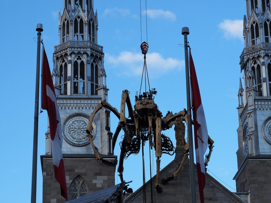 Kumo, the giant spider from La Machine, perched on top pf Notre Dame Cathedral Basilica.