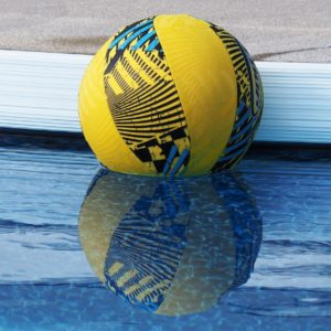 Blue and yellow ball reflected in pool.