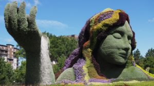 Mother Earth figure in floral or horticultural art