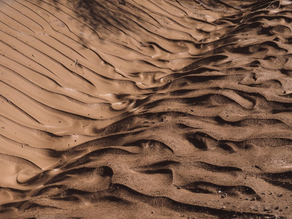Ripples of mud in a desert wash after a flood in Phoenix.