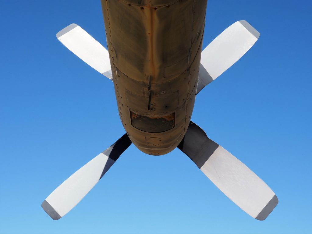 Four propeller blades, seen from behind.