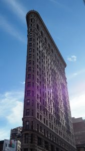 Wide-angle but vertical shot of iconic Flatiron Building, NYC.