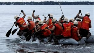 Recruits paddling dinghy.
