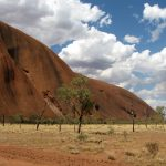 View of one end of Uluru (Ayer's Rock) with desert in foreground.