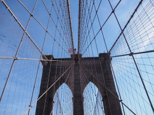 Overhead view of tower of Brooklyn Bridge and nest of cables