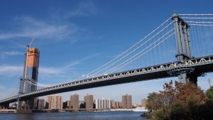 Shore-level view of Manhattan Bridge towers and span to Manhattan