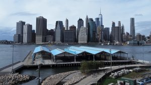 Brooklyn Bridge Park in foreground, with East River and Manhattan skyline in background
