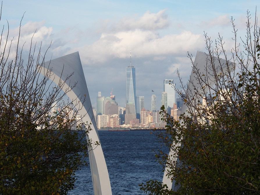 Staten Island 9/11 memorial in foreground; World Trade Center 1 in background.