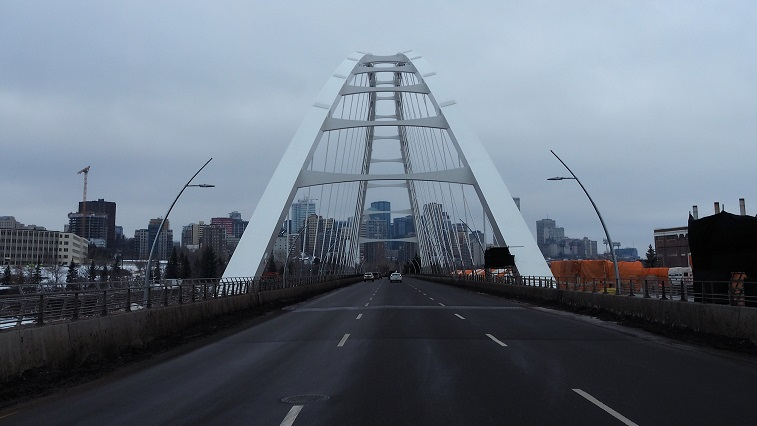 Straight-on view of Walterdale Bridge, with lanes of traffic.