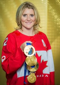 Hayley Wickenehiser with Olympic and world medals