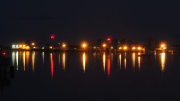 Coloured lights reflected in water of Comox Harbour.