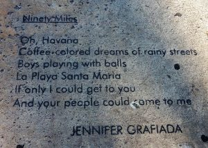 Poem craved in sidewalk near the 90-mile buoy.